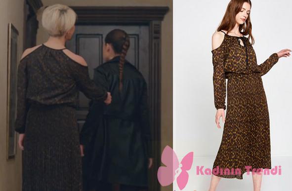 İçerde 36. bölümde Yeşim'in giydiği omuzları dekolteli siyah desenli elbise Koton marka.
