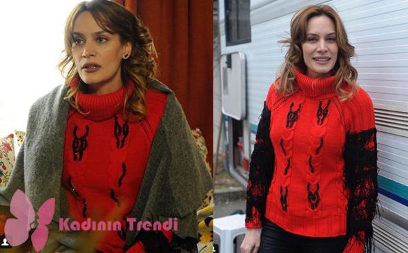 Gülizar dizisinin Suzi'sini canlandıran Ebru Cünbeyoğlun'un 5. bölümde giydiği kollarında siyah püskülleri olan kırmızı triko kazağın markası Drape Butik.