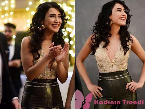İstanbullu Gelin dizisinin son bölümünde Senem'in düğününde Dilara'nın giydiği ispanyol paça pantolon ve bluz Özgül Engin tasarımıdır.