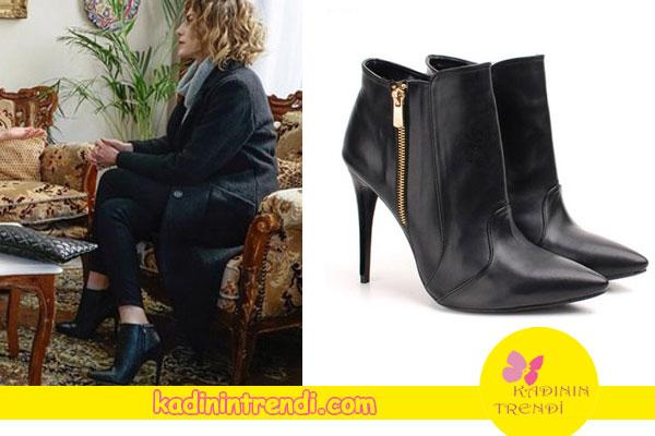 Paramparça dizisinin 84. Bölümünde Dilara'nın giydiği Siyah topuklu botların markası Gökhan Talay.